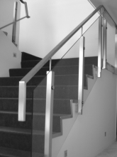 Stainless handrail with glass balustrade for internal stair custom made in Christchurch by Metalcraft Engineering